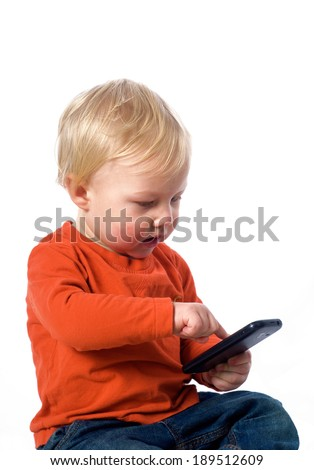 Baby boy with smart phone - stock photo