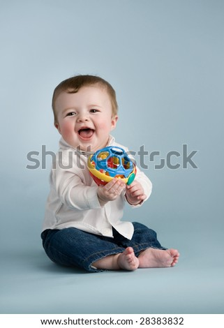 baby boy with toy - stock photo