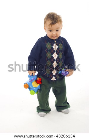Baby boy with toy on white background - stock photo
