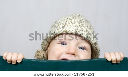 Baby boy with winter hat - stock photo