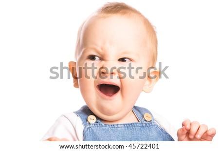 Baby boy yawns isolated on white background - stock photo
