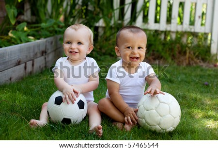 Baby boys with soccer balls - stock photo