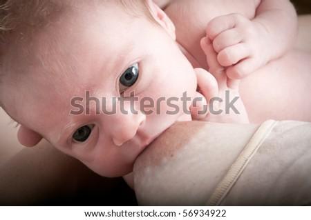 Baby breastfeeding - stock photo