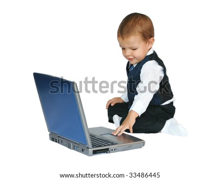Baby businessman working on a laptop computer