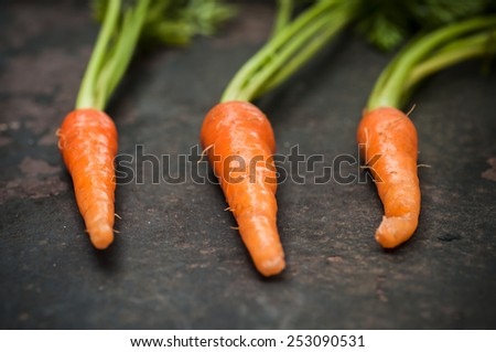 Baby carrots on grunge background, Shallow depth focus. - stock photo