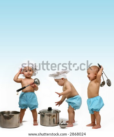Baby chef - kitchen - stock photo