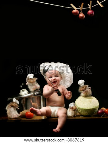 baby chef - little girl in the cook hat and hamsters - stock photo
