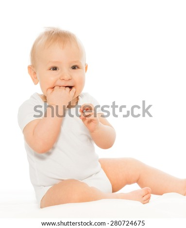 Baby chewing his fingers happy and smiling - stock photo