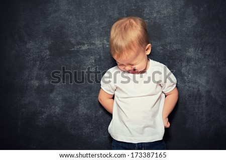 baby child and an empty  black Blackboard - stock photo