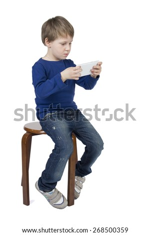 Baby, child boy call, talking, plays on tablet, cell phone, mobile phone isolated on white background. - stock photo