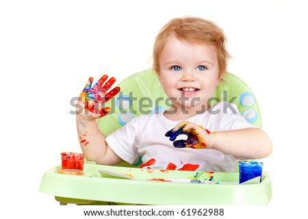 baby child creates art picture with paints as artist - stock photo