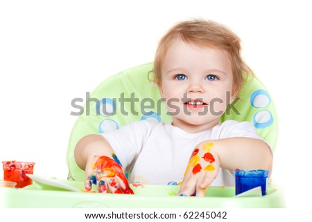 baby child creates art picture with paints as artist (#2 from series) - stock photo