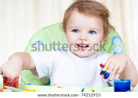 baby child creates art picture with paints as artist (#5 from series) - stock photo
