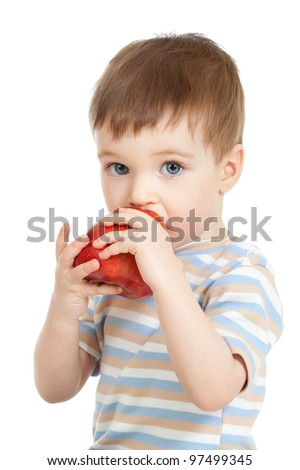 Baby child holding and eating red apple, isolated on white