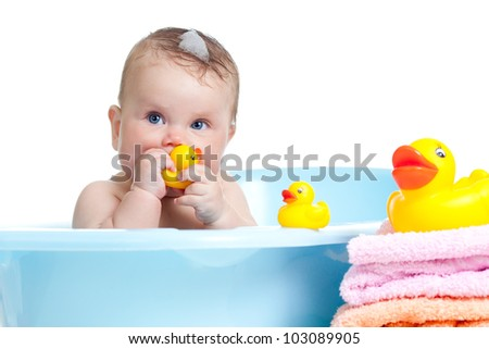 baby child taking bath and playing - stock photo