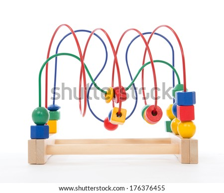 Baby child wooden educational toy with looped wires for teaching coordination yellow, re, blue and green - stock photo