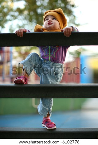 baby climbing to stairs - stock photo