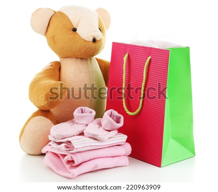 Baby clothes and gift bag isolated on white - stock photo