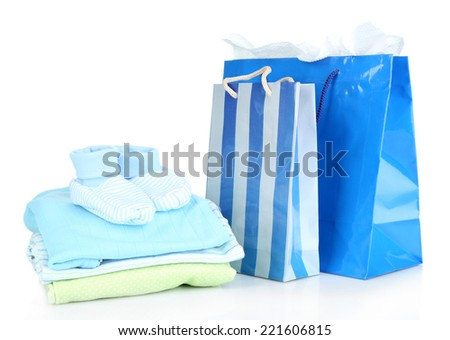 Baby clothes and gift bags isolated on white - stock photo