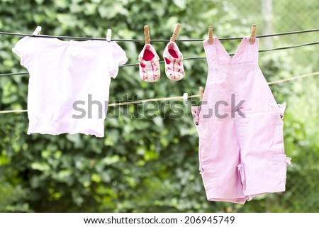 Baby clothes hanging on the clothesline - stock photo