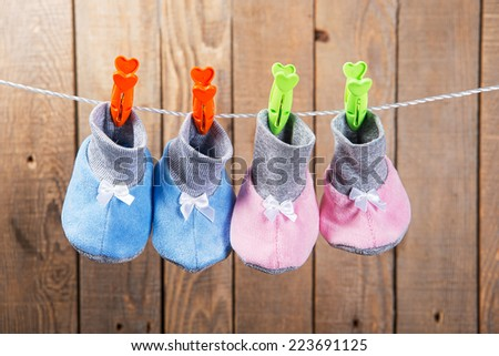 baby clothes on clothesline - stock photo