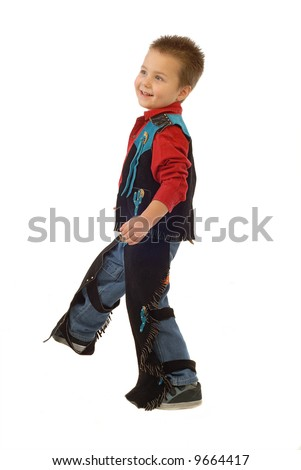 Baby cowboy in a cute outfit playing around on white background - stock photo