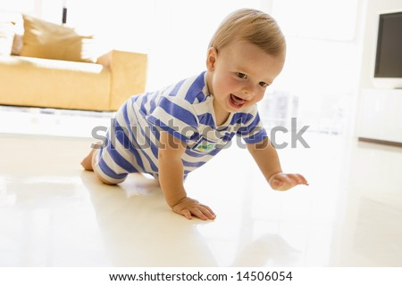Baby crawling in living room - stock photo
