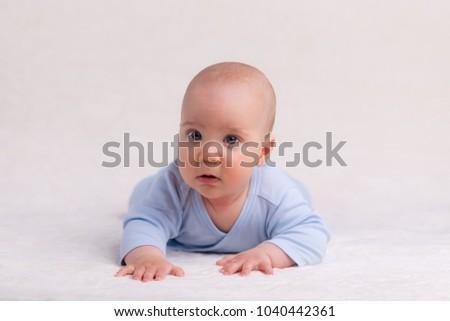 stock-photo-baby-crawling-on-carpet-1040