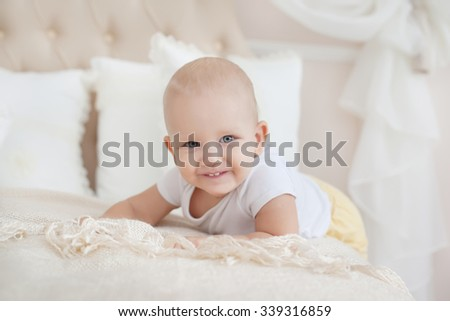 baby crawling on the bed, close-up - stock photo
