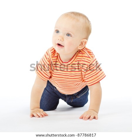 Baby crawling over white background. Active one year child - stock photo