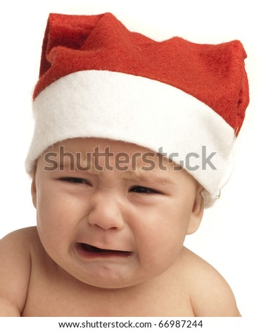 baby crying with christmas hat on white background - stock photo