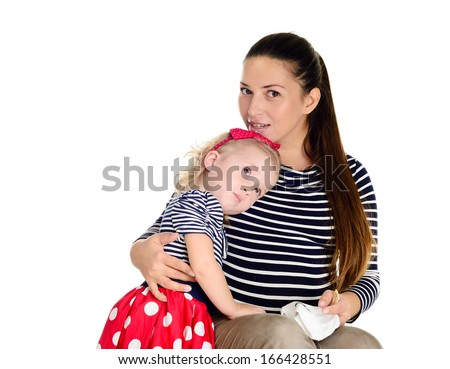 baby daughter hugging pregnant mother - stock photo