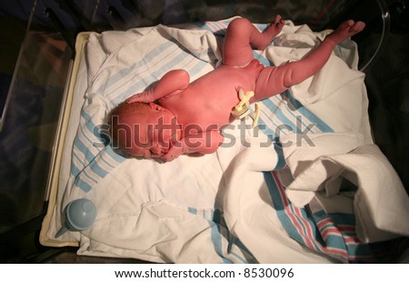 Baby delivered only a few seconds before - stock photo