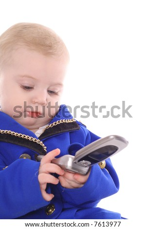 baby dialing on cellphone - stock photo