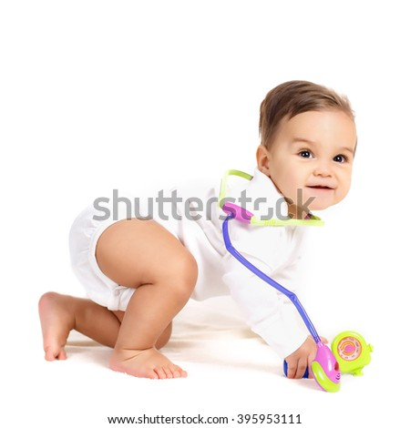 baby doctor. Infant child medicine. Little kid playing a doctor. Sweet baby with stethoscope on a white background. - stock photo