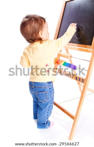 Baby drawing on the blackboard, isolated - stock photo