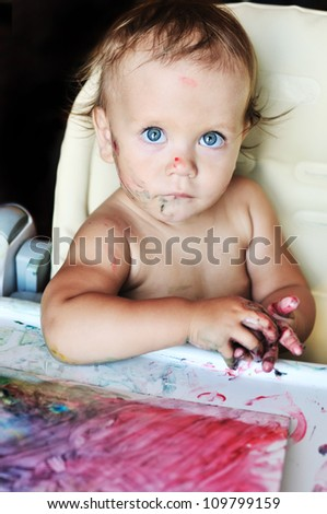 baby drawing with her fingers - stock photo
