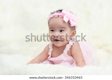 Baby dressed in a beautiful princess in the living room.