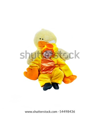 Baby dressed in baby duckling costume, cuddles with its mother counterpart, a stuffed giant yellow duck.  Isolated on white. - stock photo
