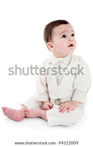 Baby dressed in Christening outfit - stock photo