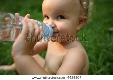 baby drink from bottle of water