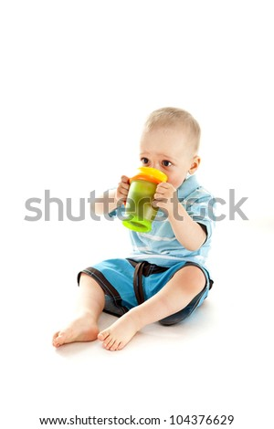 baby drinking a juce on white background