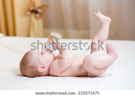 baby drinking water from bottle - stock photo