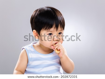 Baby eat finger food - stock photo