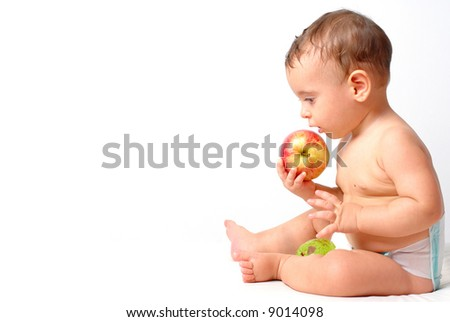 Baby eating a apple on white background .