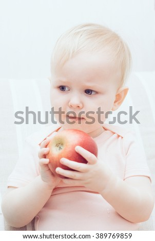 baby eating an apple