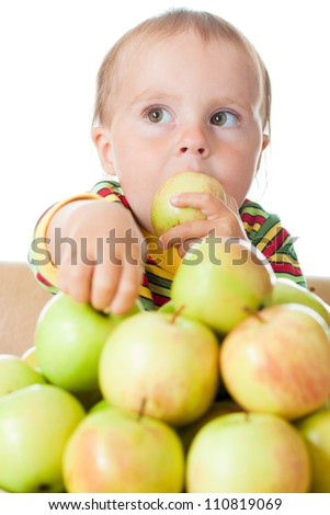 Baby eating apple on a white background.