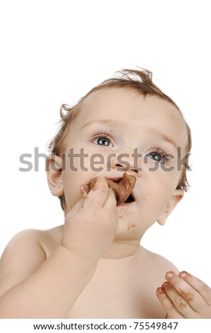baby eating chocolate, and looking up for your text - stock photo