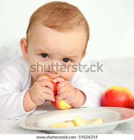 baby eating fruit - stock photo