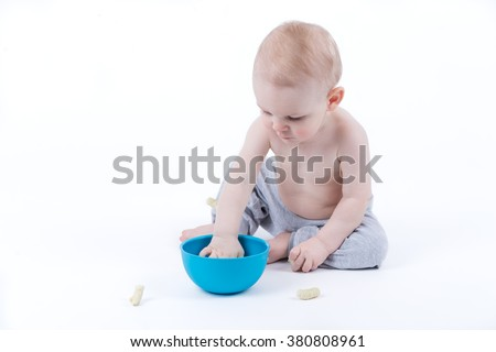 baby eating healthy crisps